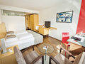 Execuitve Room with kingsize bed and seating area | Hotel Congress Innsbruck