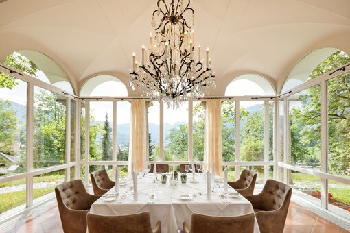 "Restaurant ""Residenz"" conservatory overlooking snowy mountains 