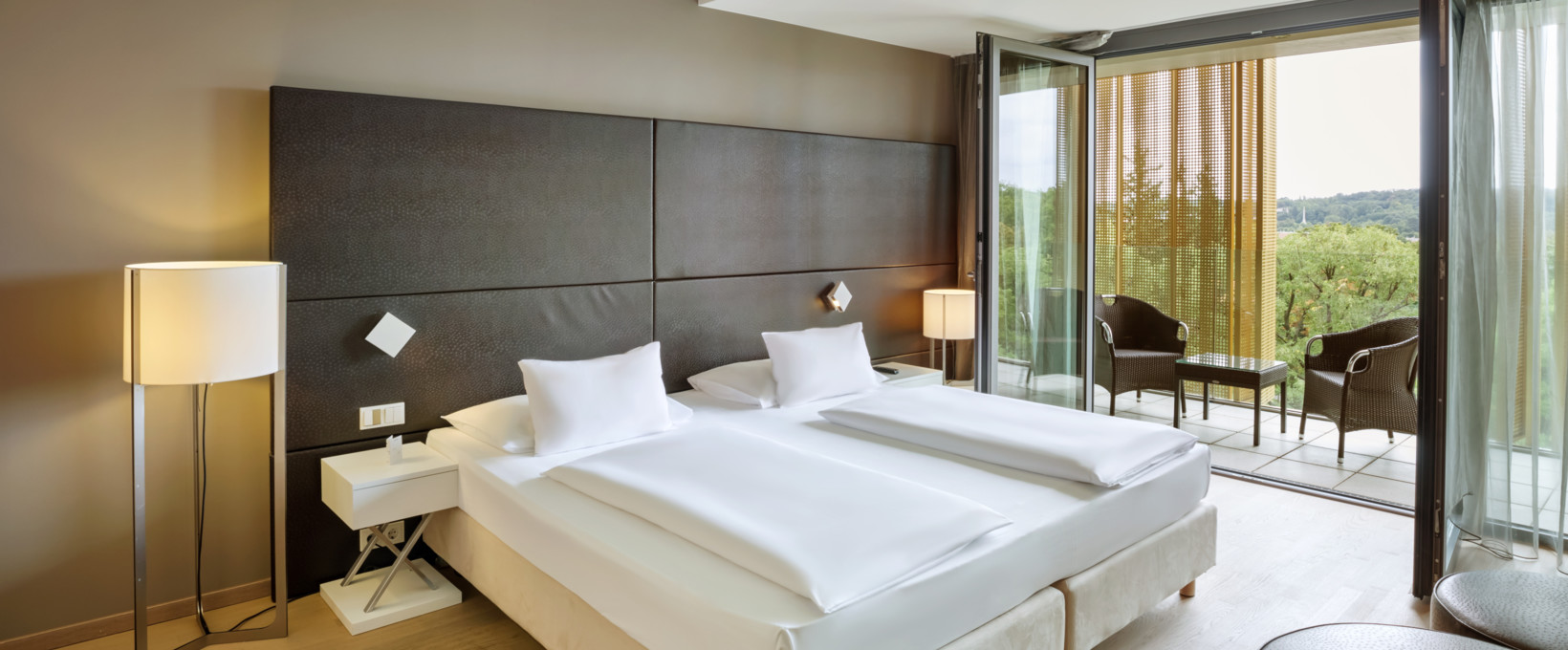Suite bedroom with double bed | Radisson Blu Park Royal Palace Hotel in Vienna